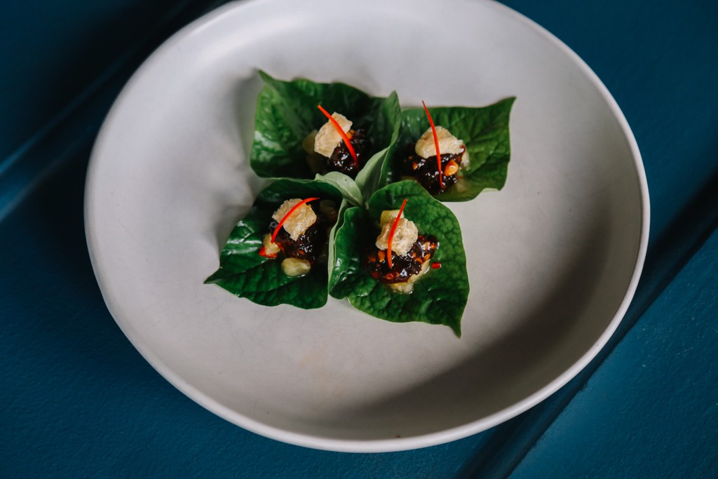 Betel Leaf with caramelised pork, prawn and chicken