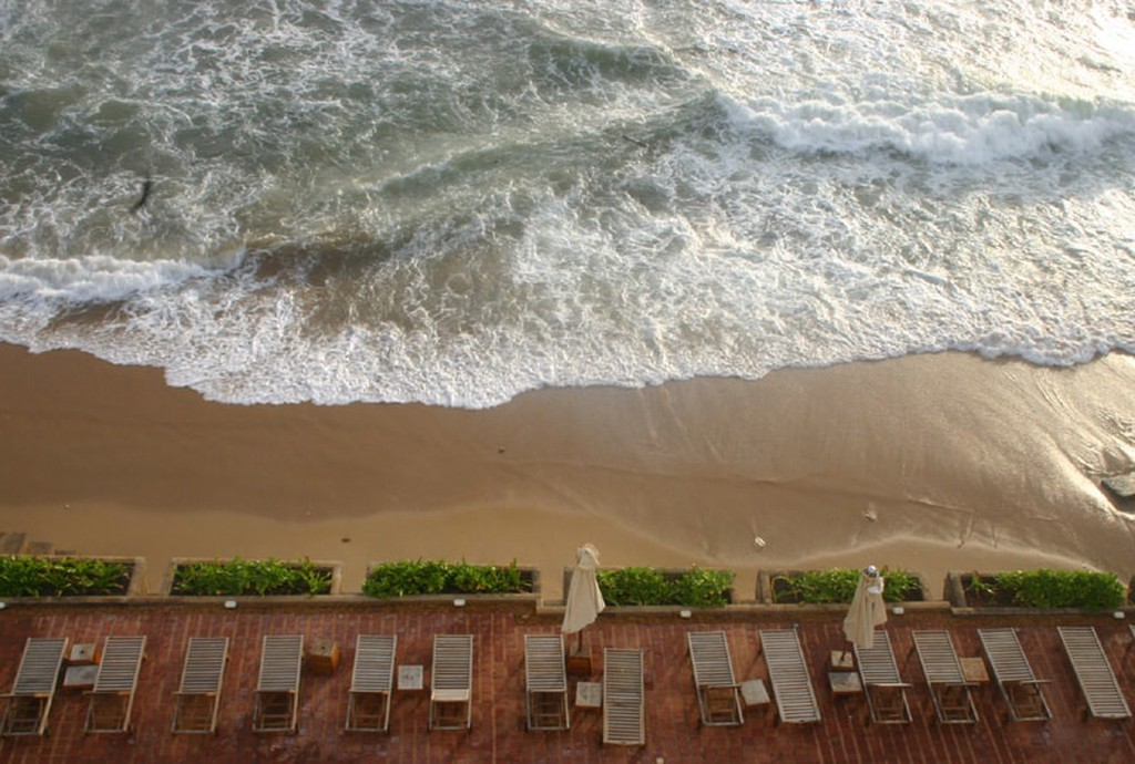 The poolside at Galle Face Hotel is by the ocean