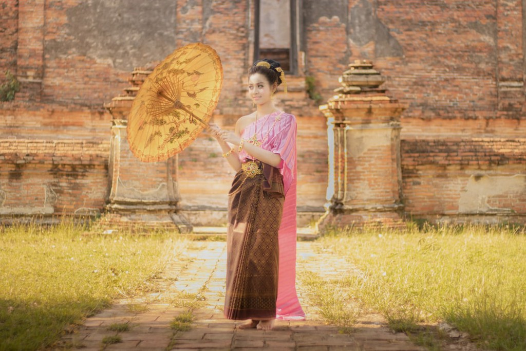 Asian woman wearing traditional Thai dress
