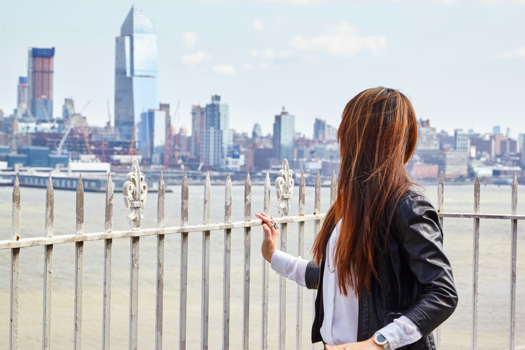 Woman gazing at the city skyline.