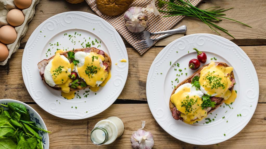 Eggs Benedict with little salad, milk and fresh herbs ©Stepanek Photography / Shutterstock