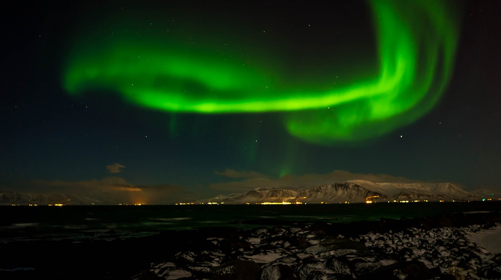 Northern Lights over Reykjavik | © sergejf / Flickr