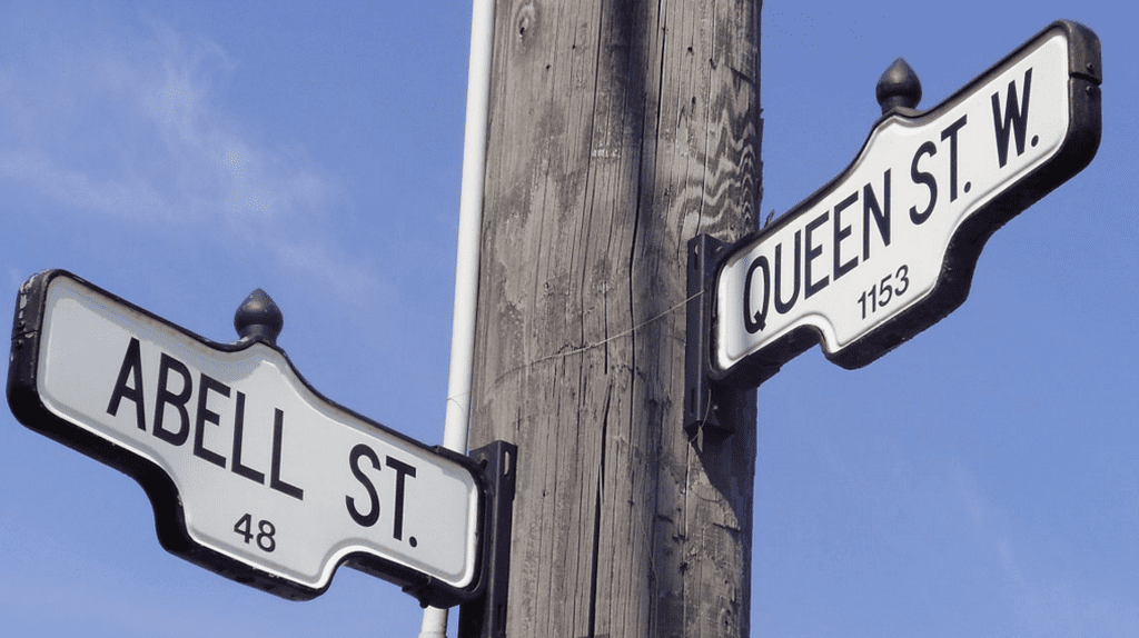 Street signs for Queen Street West and Abell Street   GTD Aquitaine
