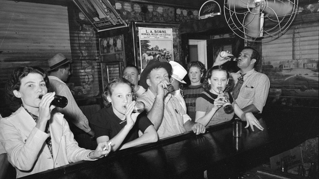 'Drinking Beer at the Bar,' Louisiana, September 1938  Public Domain / Russell Lee / WikiCommons