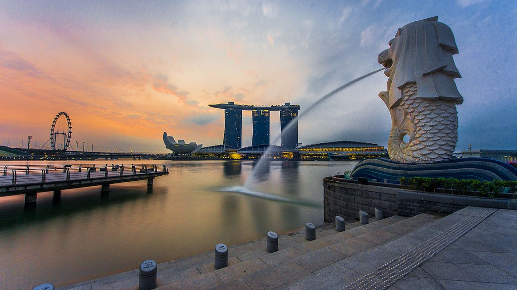 Rear view of Merlion with Marina Bay Sands in the distance