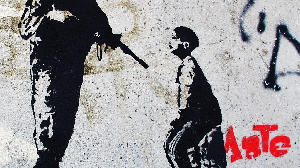 Street art questioning how passive the 'pacification' of the favelas by police officials really was |© candypilargodoy/Flickr