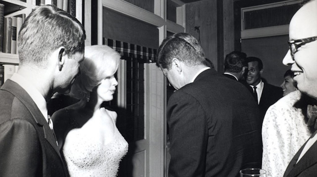 Monroe with US Attorney General Robert F. Kennedy and President John F. Kennedy at the 1962 birthday celebration   ©Cecil W. Stoughton