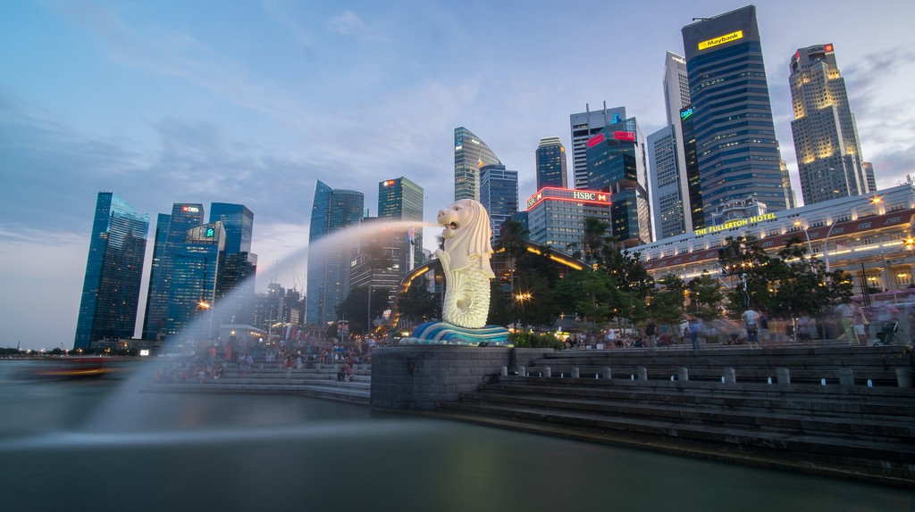 Singapore Merlion at Marina Bay against the city skyline in the evening