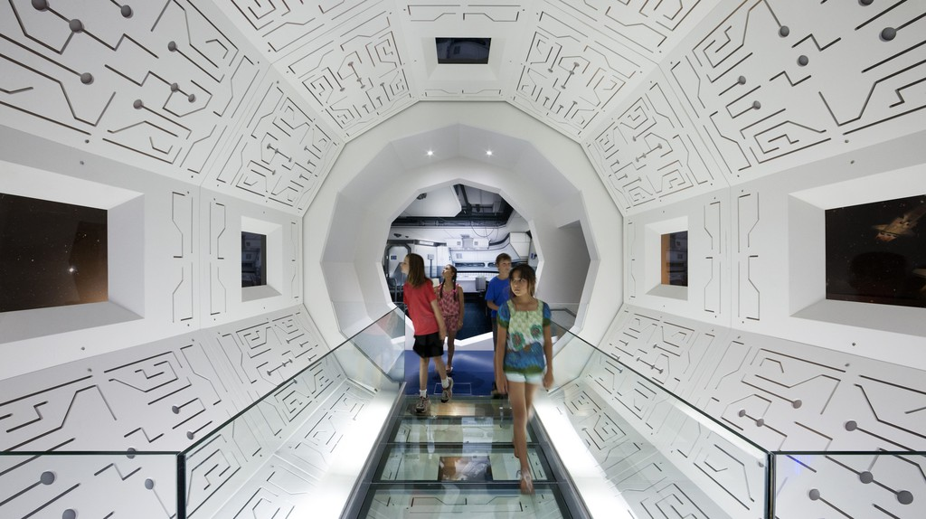 Think Ahead Exhibition, Scienceworks. Children exploring the 'Life in Space' installation. White panels, space ship like interior.   Courtesy of Scienceworks