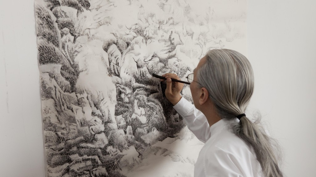Liu dan painting a portion of a landscape, © Britta Erickson