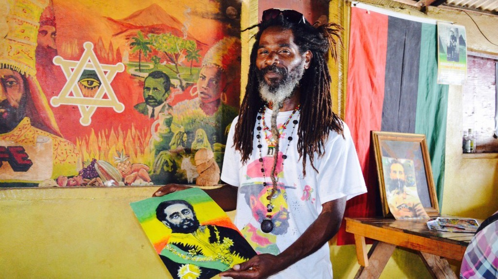 Artist Future with painting of Haile Selassie, Jah Moon's, Hellshire Beach, Portmore  | © Caribbean Cables