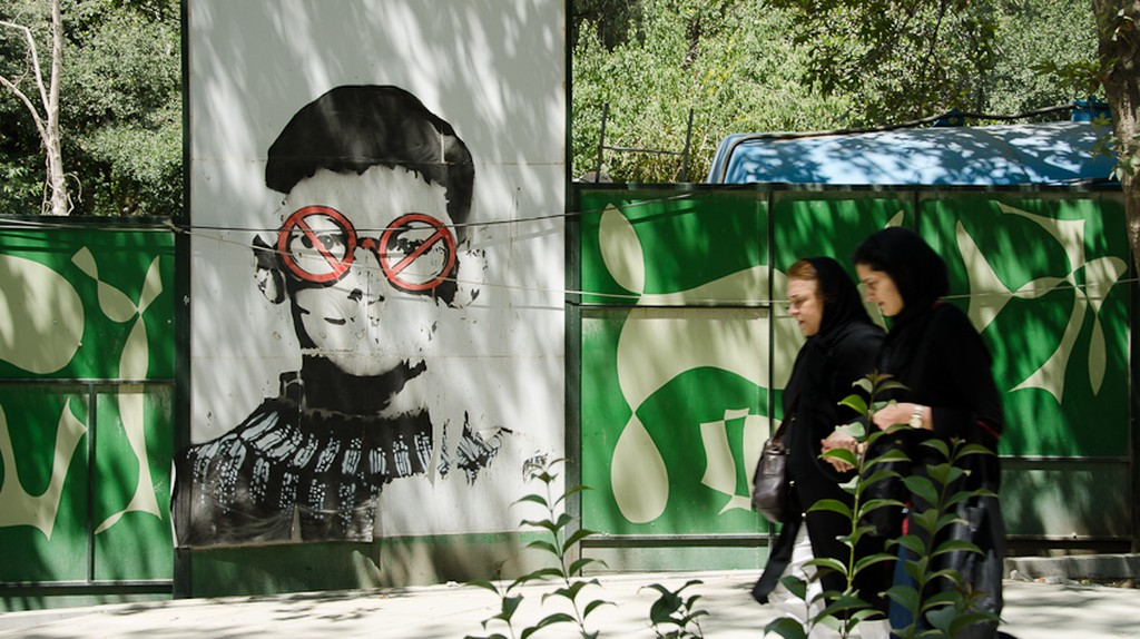 Two women walk by the street art of ICY and SOT   © Kamyar Adl / Flickr