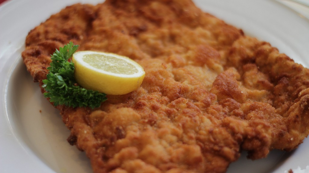A traditional wiener schnitzel served with lemon