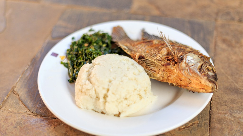 Ugali with fried fish | © Sopotnicki / Shutterstock