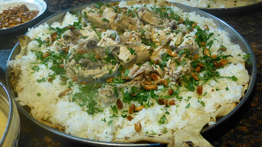"<a href=""https://commons.wikimedia.org/wiki/File:Pr%C3%A9paration_du_mansaf-Jordanie_(8).jpg"" target=""_blank"">Jordanian Mansaf topped with herbs 