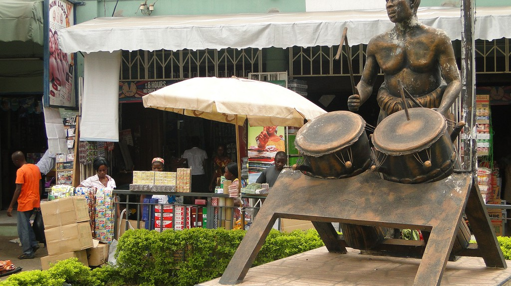 Street Scene with Sculpture of Drummer - Kumasi - Ghana