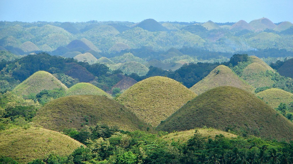 "<a href=""https://commons.wikimedia.org/wiki/File:Chocolate_Hills_overview.JPG"" target=""_blank"" rel=""noopener noreferrer"">Chocolate Hills, Bohol, the Phillipines 