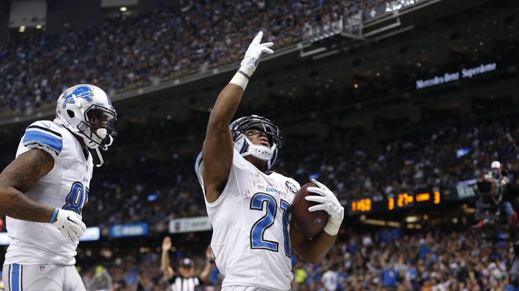Ameer Abdullah (21) celebrates a TD against the New Orleans Saints   © Brynn Anderson/AP/REX/Shutterstock