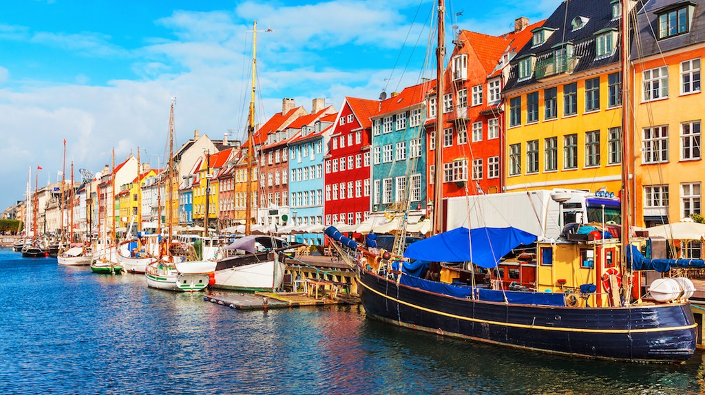 Scenic summer view of Nyhavn pier with colour buildings, ships, yachts and other boats in the Old Town of Copenhagen, Denmark   © Scanrail1 / Shutterstock