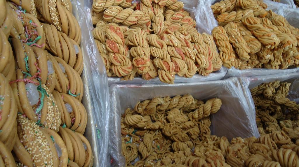 """<a href""""https://www.flickr.com/photos/santangelo-jon/4527815120""""> Tianjin Snacks    © Jon Santangelo/Flickr</a>"""