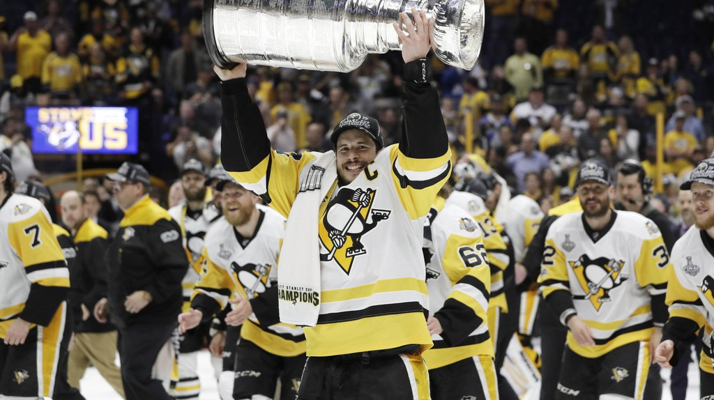 Pittsburgh Penguins captain Sidney Crosby hoisting the Stanley Cup. | © AP/REX/Shutterstock