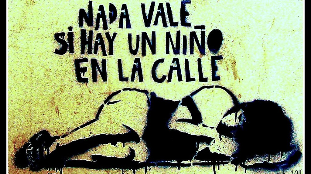 """Graffiti in Buenos Aires that says: """"Nothing is worth it if there's a child on the street""""  