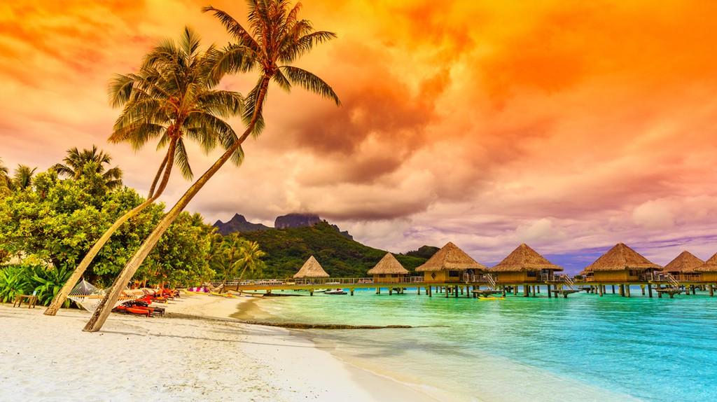 Bora Bora, French Polynesia. Otemanu mountain, beach and palm trees   © emperorcosar / Shutterstock