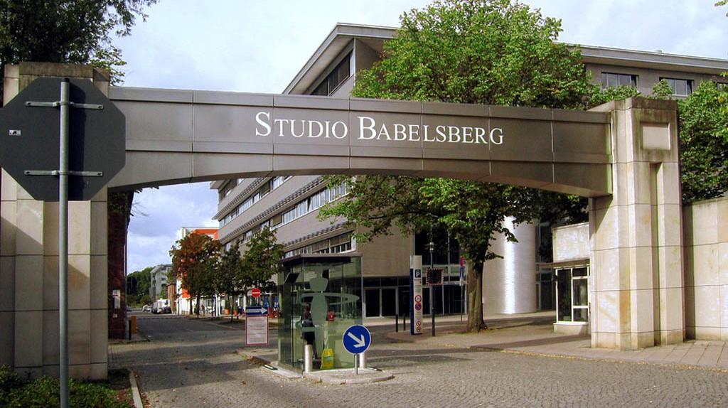 "<a href=""https://commons.wikimedia.org/wiki/File:Filmstudio_Babelsberg_Eingang.jpg"" target=""_blank"" rel=""noopener noreferrer"">Entrance to Studio Babelsberg in Potsdam | Unify / Wikimedia Commons</a>"