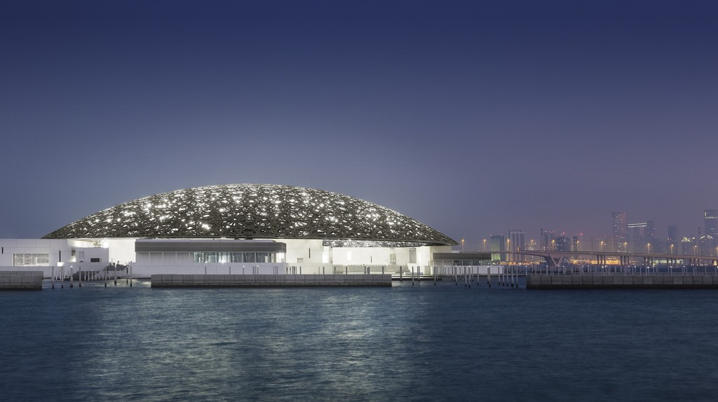 Louvre Abu Dhabi's exterior with Abu Dhabi's skyline (night) | © Louvre Abu Dhabi, Photography: Mohamed Somji