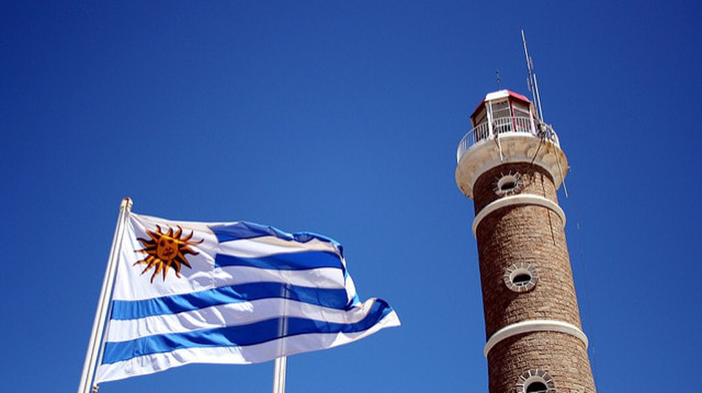 Uruguayan flag and lighthouse