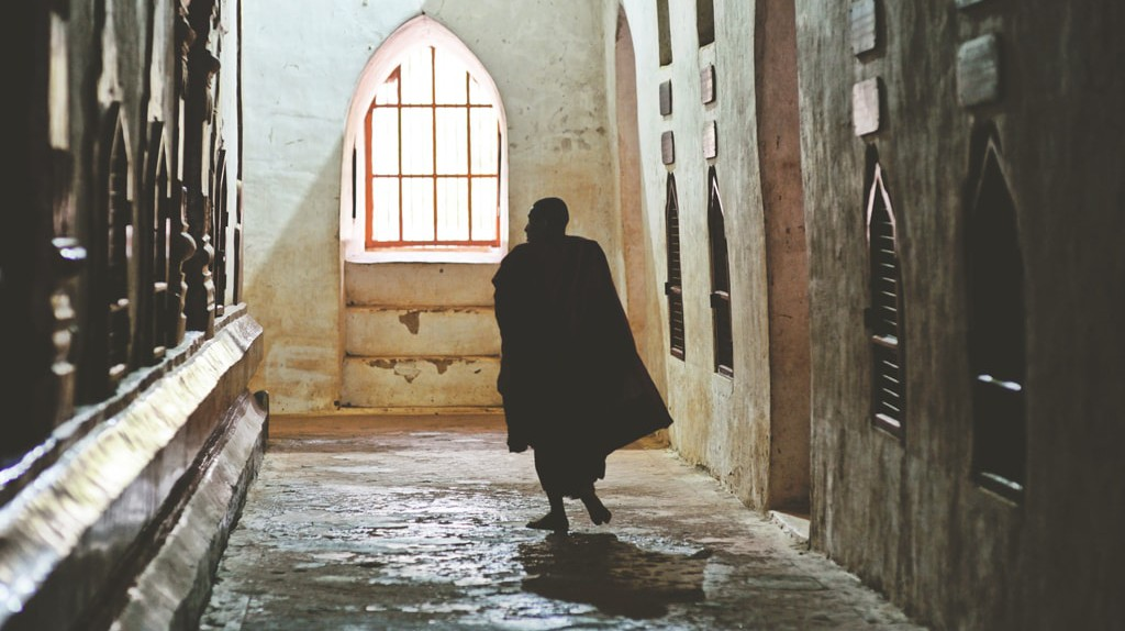 The silhouette of a monk inside a temple in Bagan, Myanmar / © Chase Chisholm