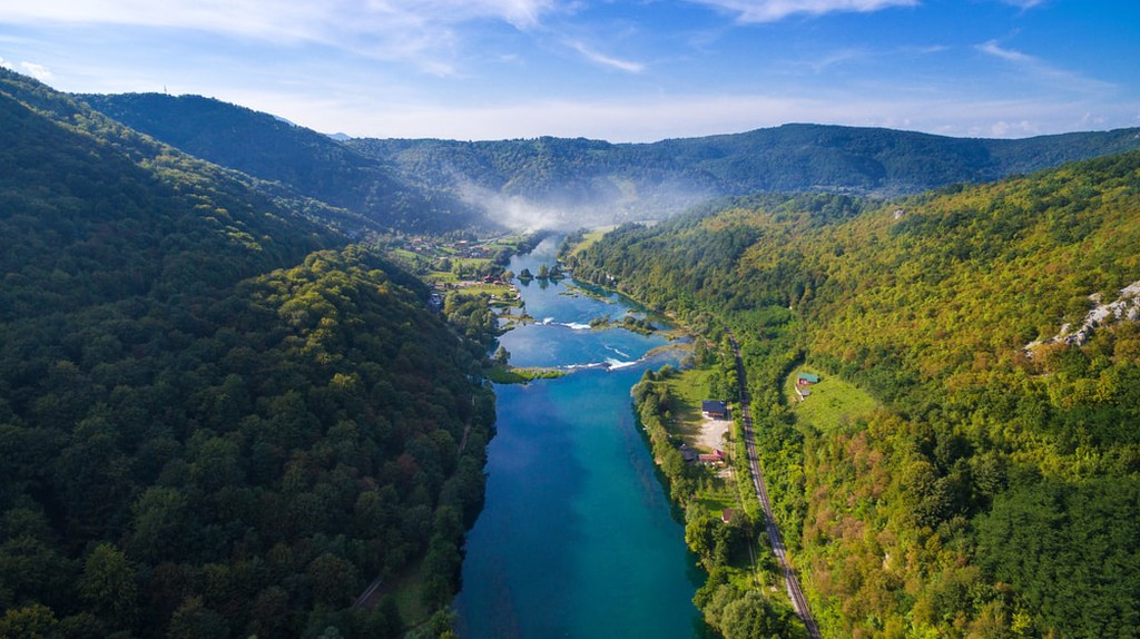 Aerial view of Una river surrounded by forest and hills, Bosnia and Herzegovina | © paul prescott/Shutterstock