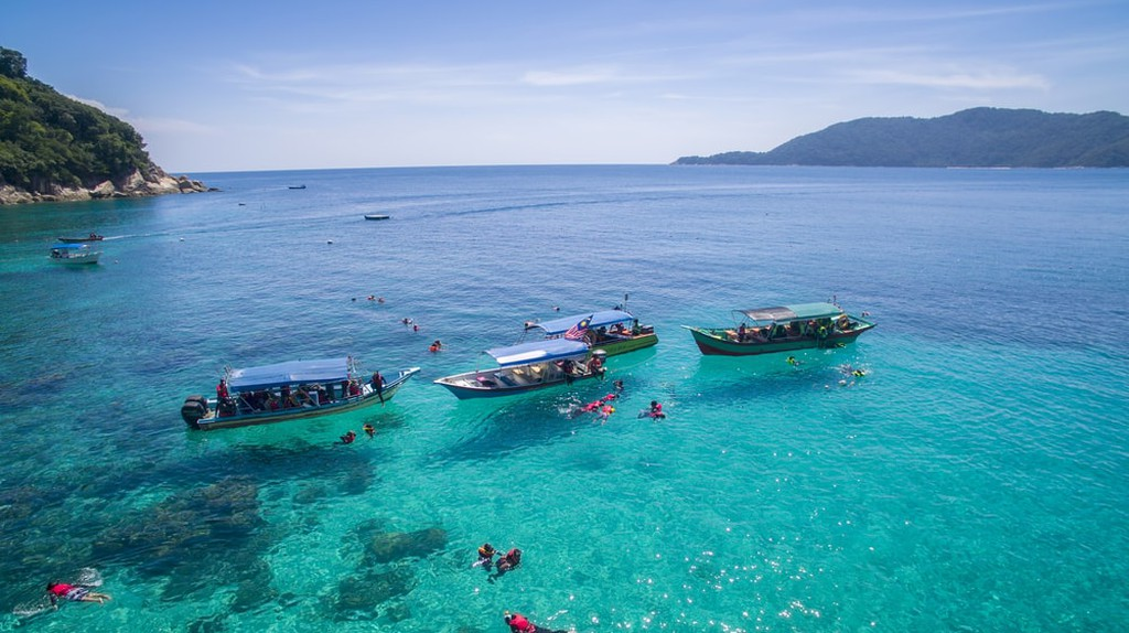 Snorkelling in clear waters of Perhentian Island