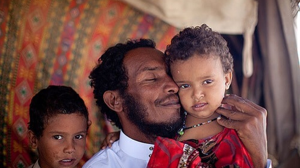 A Bedouin man and his children