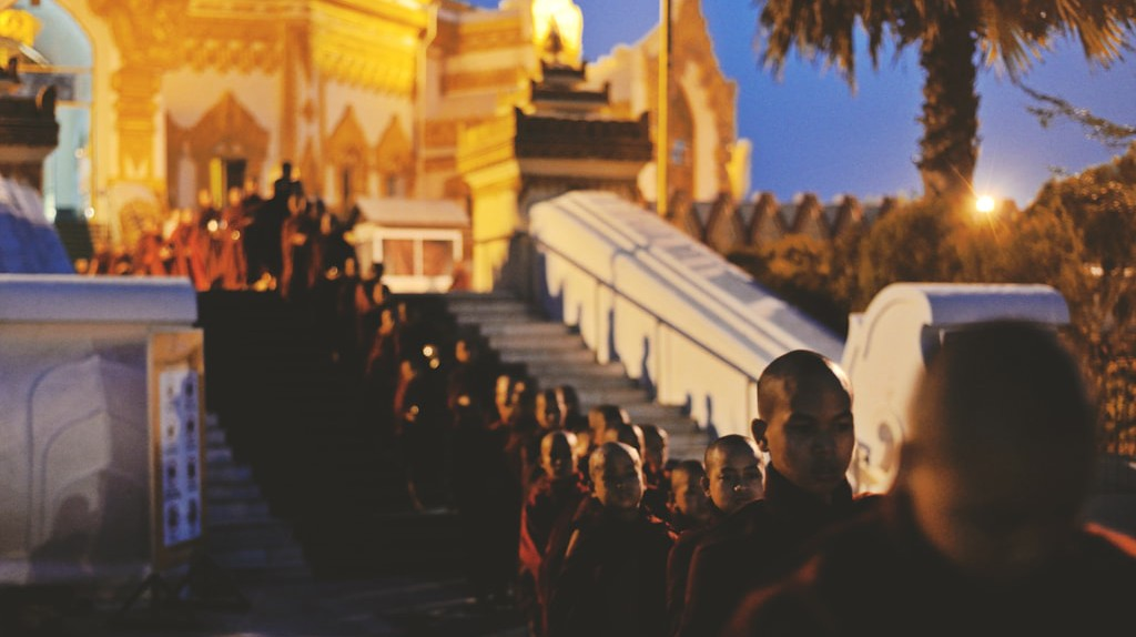A line of monks at Swe Taw Myat Pagoda in Yangon, Myanmar   © Chase Chisholm