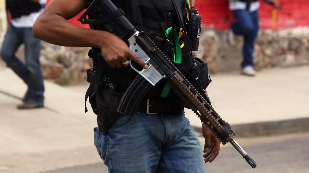 A vigilante holding a semi-automatic rifle