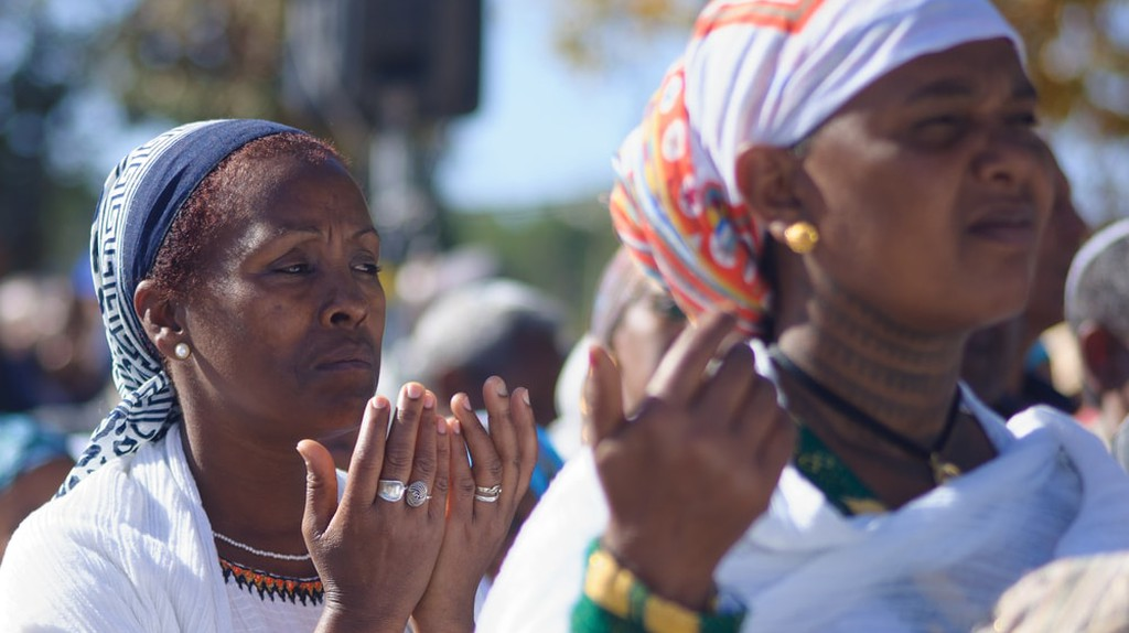 Ethiopian Jewish women pray at the Sigd in Jerusalem, Israel, 2014   © RnDmS / Shutterstock