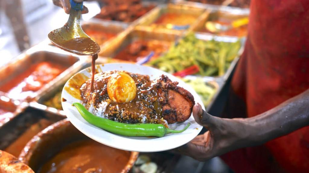 Nasi Kandar is a popular self-service dining in Malaysia