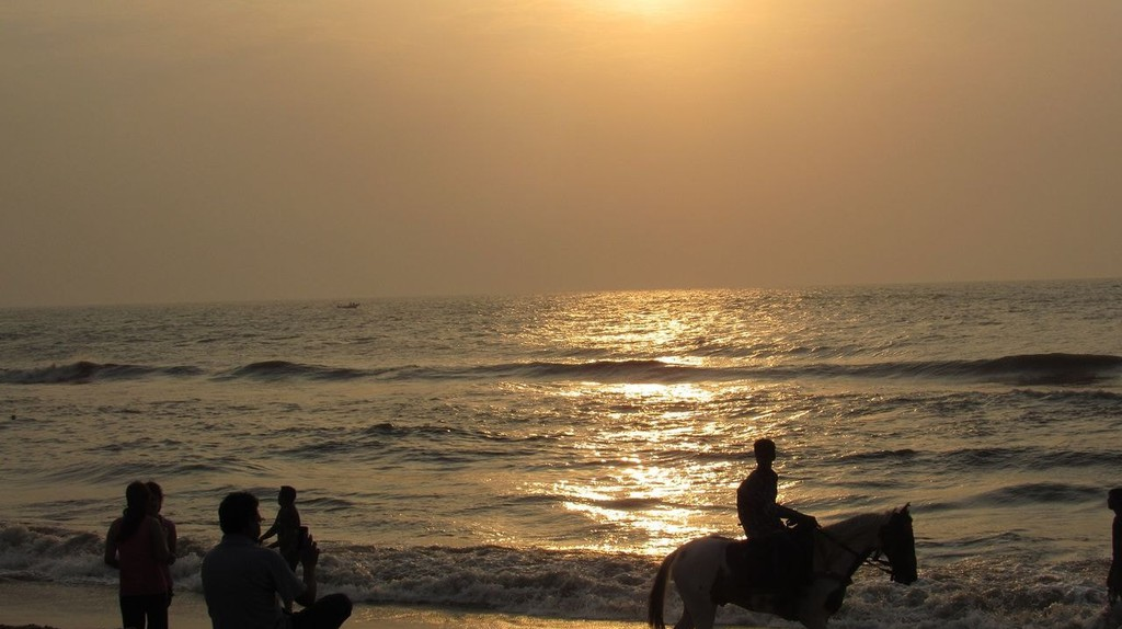 Visitors enjoying the sunrise at Besant Nagar Beach in Chennai |