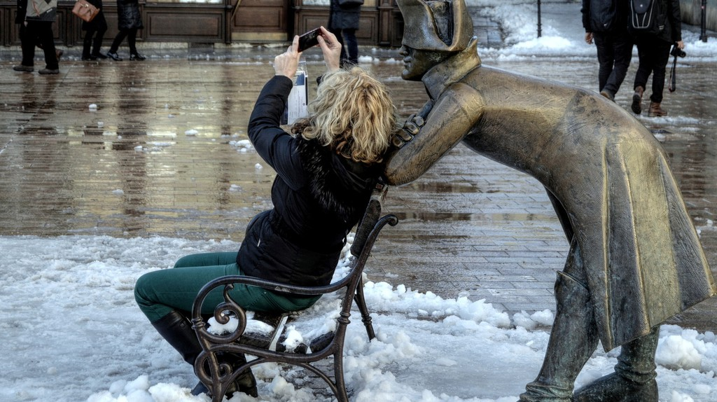 Taking a selfie with one of the statues in Bratislava's Central Square. © Lubos Houska/ Pixabay