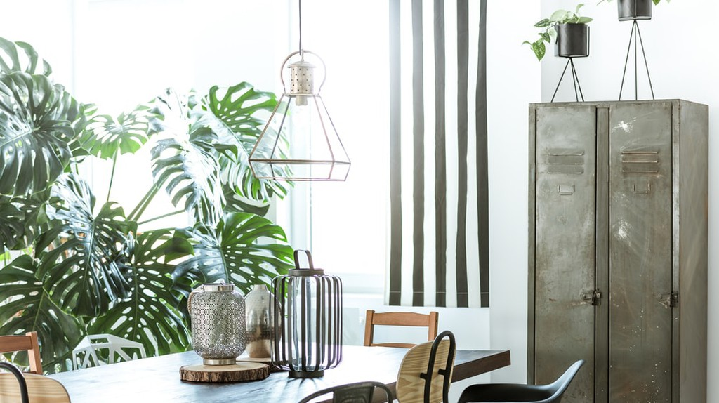 White, industrial dining room with metal wardrobe and wood table   @ Photographee.eu/Shutterstock