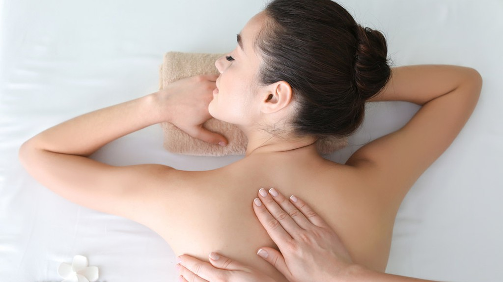 Woman receiving massage in spa
