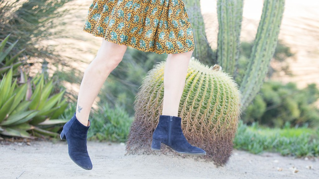 Blogger Vanessa Valiente jumps for joy in her winter boots