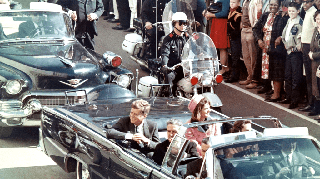 John F. Kennedy in his motorcade minutes before his assassination