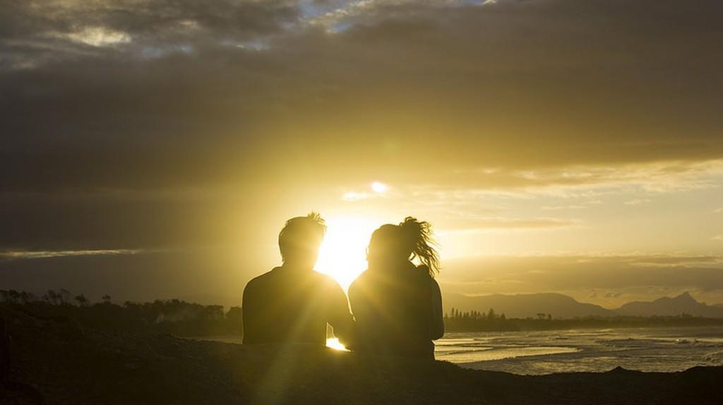A couple enjoying the sun set