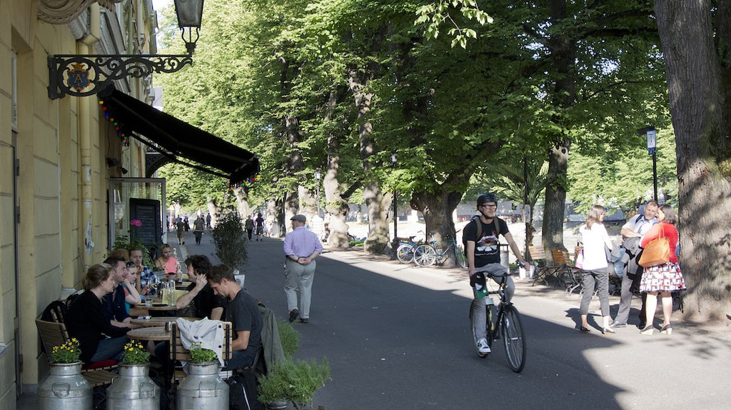 Cycling along Aura River in Turku, Finland.