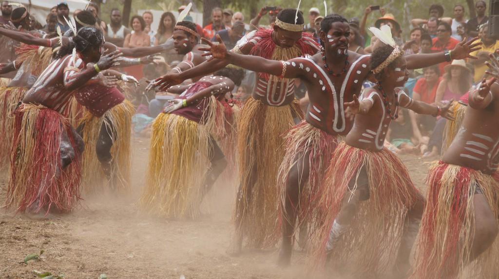 Indigenous Australians perform a cultural ceremony