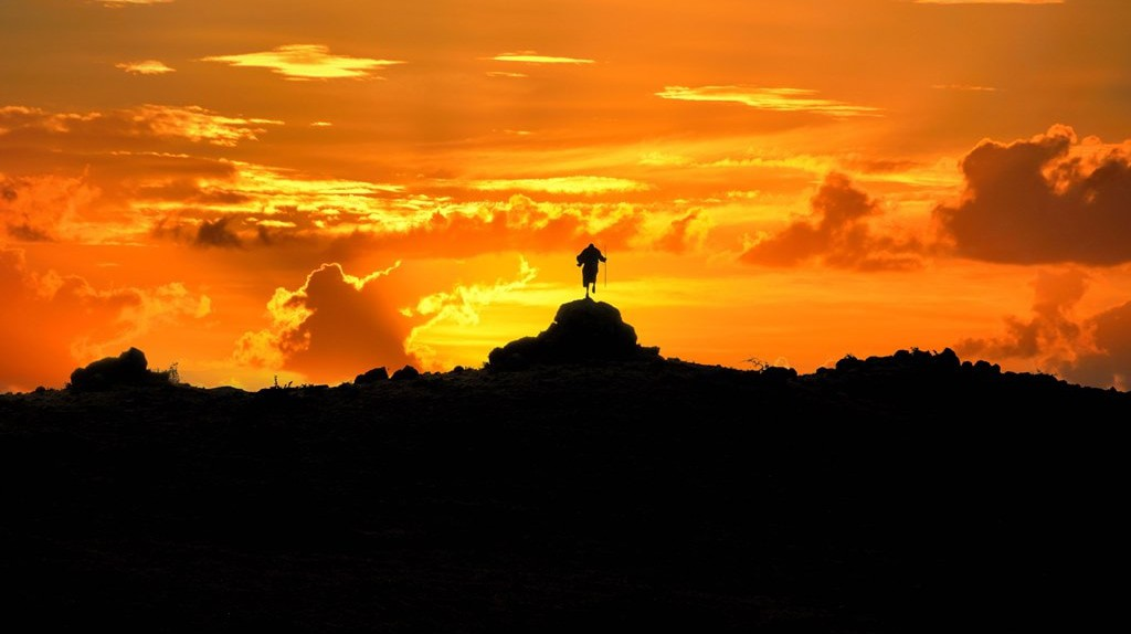 Maasai man burning sky