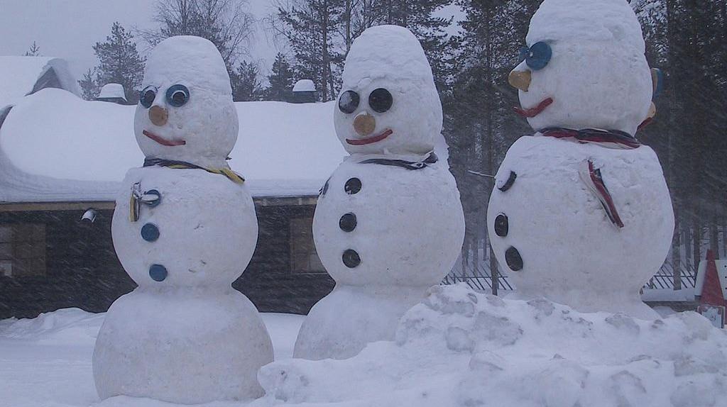 Snowmen sculptors greet visitors to the Santa Claus Village in Rovaniemi.