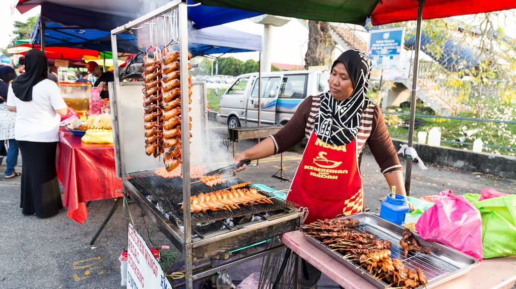 Vendor selling cuisine at street bazaar, Kuala Lumpur, Malaysia